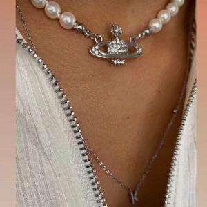 vivienne westwood pearl mini bas relief choker